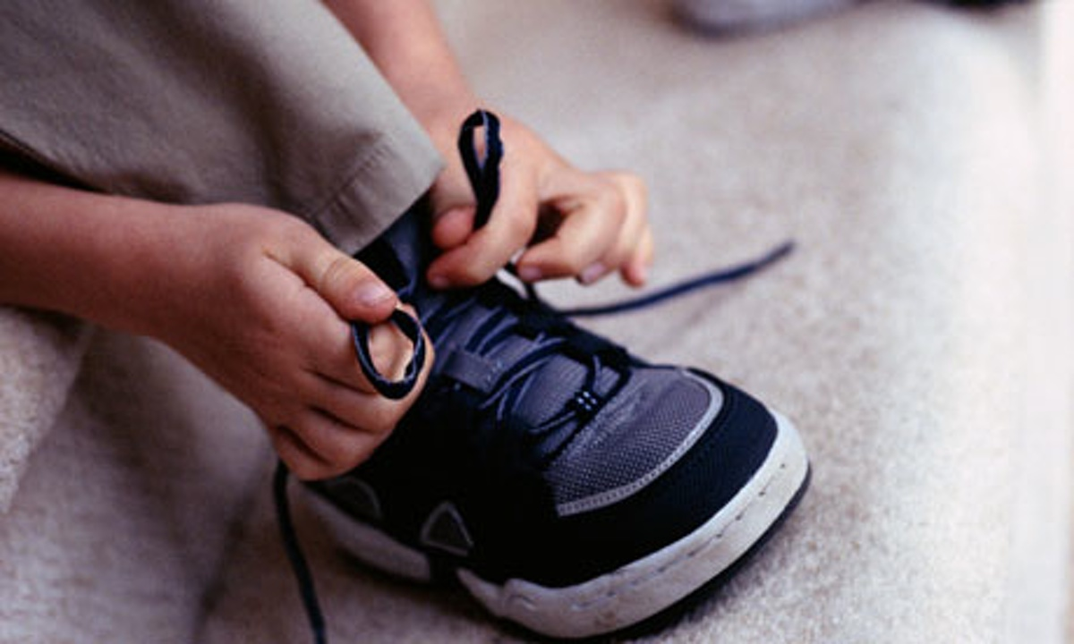 Kid Tying Shoes